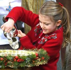 Princess Estelle of Sweden pouring out the water for the christening. The water for the christening was taken from a spring on the Swedish island of Öland.
