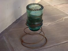 Glass insulator w/ spring.