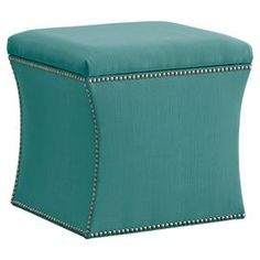 Linen storage ottoman with pine wood frame and nailhead trim. Handmade in the USA.   Product: Storage ottomanConstruction Material: Pine, linen polyurethane and polyester foamColor: Linen lagunaFeatures:  Handmade in the USAOrnamental nailhead accentsRemovable lid Dimensions: 19 H x 19 W x 17 DNote: Easy assembly requiredCleaning and Care: Spot clean only