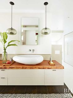 The vanity is the focal point of most bathrooms. For a low-cost, low-fuss upgrade to your existing cabinet, try replacing the top. Use our guide to weigh the pros and cons of some popular vanity top materials. Best Bathroom Vanities, White Vanity Bathroom, Modern Bathroom, Master Bathroom, Bathroom Renovations, Home Remodeling, Kitchen Bath Collection, Small Vanity, White Sink