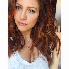 Love this wavy dark red hair color.