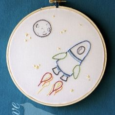 Possible quilt block -- This rocket ship embroidery would look fabulous in any little boys room - BLAST OFF!!