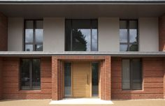 This new-build, low-carbon house, is situated on a conventional residential street in Wimbledon, London. Whilst there are references of 20th-century suburban architecture externally, the interior is decidedly modernist with an emphasis on open space, light and sharp minimalist detailing.