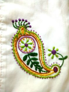 This is my first attempt at embroidery.  Hand embroidered paisley pillowcase, pattern idea from link