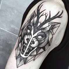 Geometric Wolf Tattoo Design and Idea on Upper Arm for Men