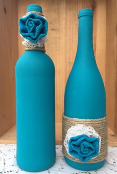 Teal wine bottles with matching burlap flowers, twine, and lace by TwinenWineCreations on Etsy