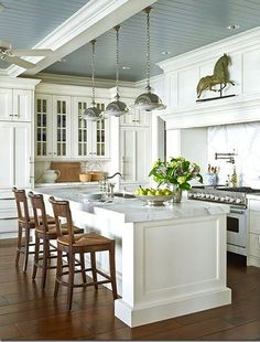 white kitchen with painted ceiling