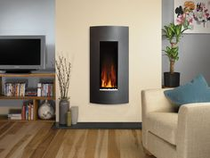 With an eye-catching curve and five stylish finishes, the Gazco Studio Verve fire instantly creates a designer look in your living room and is the perfect way to accentuate the modern landscape flame picture provided by each of the three fire sizes. Focus Fireplaces, Fireplaces Glasgow, Inset Fireplace, Fireplace Design, Flueless Gas Fires, Living Room Designs, Living Spaces, Living Rooms, Flame Picture