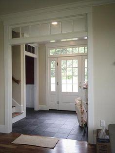 Foyer/love door and side panel of windows. Also, love entry way floor