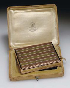 A JEWELED, ENAMEL AND TWO-COLOR GOLD CIGARETTE-CASE  BY FABERGÉ WITH THE WORKMASTER'S MARK OF HENRIK WIGSTRÖM, ST. PETERSBURG, 1908-1917, WITH SCRATCHED INVENTORY NUMBER 22529, WITH ENGLISH IMPORT MARKS FOR 1904-1932  with original fitted wood case, stamped in the cover in Cyrillic 'Fabergé' with the Imperial Warrant, 'St. Petersburg, Moscow, London', marked inside cover and base.