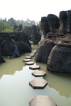 Water walkway through sculpted rocks, Wansheng Stone Forest, Yunnan, China