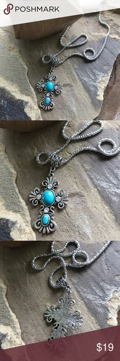 Turquoise silver tone cross necklace Silver tone cross necklace with turquoise semi precious stone. Matching earrings and bracelet available. 2 in stock. Chain is approx 20 inches plus extender. Price is firm unless bundled. Boutique item. Excellent quality. Jeep Girl Glam Jewelry Necklaces