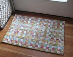 Woven Jelly Roll Rug {for by the door?}