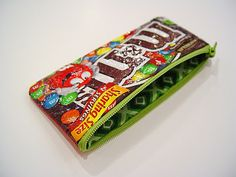 Sweet tooth pouch made from candy wrappers! Tutorial from Punkin Patterns; this is a great tutorial - easy to follow and the pouch looks so fun!