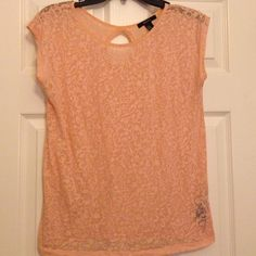 Cute Light Pink Top This cute light pink top is perfect for a summer or spring day! It's a bit flowy when it's worn but it's super cute. It may look quite big in the picture but it is a size medium and it's 59% polyester and 41% cotton. Let me know if you're interested! Forever 21 Tops Blouses