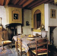antique portrait and bedwarmer near recessed bed in 17th century home