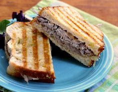 Roast beef panini recipe with caramelized onions and horseradish cheese sauce from The Perfect Pantry