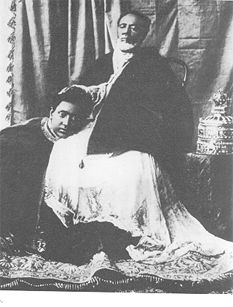 Lij Eyasu with his father, King Michael of Wollo. The crown of Emperor Menelik is placed to the King's left