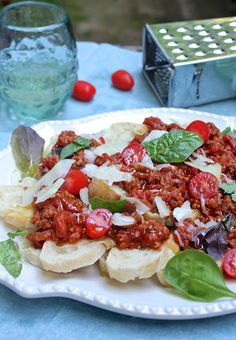 Italian Nachos - you might have been asking yourself, huh? Oh, let me tell you. Heaven on a plate. It's kind of a great alternative to chip nachos. A bread lovers dream.