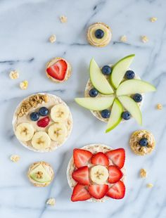 "This healthy fruit pizza is a perfect healthy after-school snack! Rice cakes spread with a creamy peanut butter yogurt ""sauce"" and topped with fresh fruit."