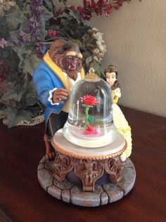 Beauty and the Beast Snowglobe, http://www.amazon.com/dp/B00G7Z0UYI/ref=cm_sw_r_pi_awd_bahBsb0YR425H