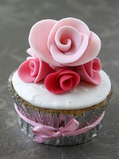 Wedding cupcake with ribbon and large rose by flickan & kakorna, via Flickr