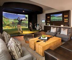 A New Golf Clubhouse at the Yellowstone Club - Mountain Living Home Golf Simulator, Indoor Golf Simulator, Star Citizen, Clubhouse Design, Yellowstone Club, Golf Room, Golf Simulators, New Golf, Mountain Living