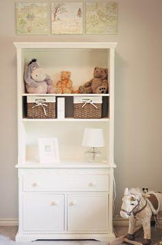 Pastel baby boy nursery with classic Winnie the Pooh theme - bookshelf.