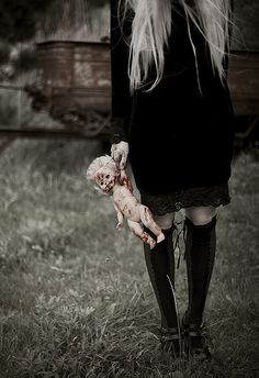 <3 Girls with bloody doll