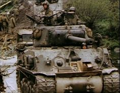 An M4A3 (76mm) W HVSS of 11th Armored Division crosses the Muhl river in Austria, Spring 1945. A Dodge weapons carrier follows it and behind that an M4A3E2 Sherman Jumbo.