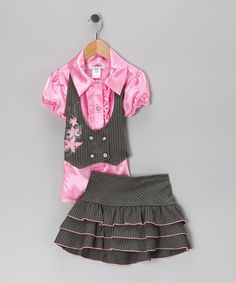 A put-together pairing, this USA-made set features a tie-back vest, a silky-smooth blouse and tiered skirt. Plus, the skirt has a comfy elastic waistband in back and built-in shorts, combining playful with posh.Includes top, vest and skirtTop: 100% polyesterVest and skirt: 80% polyester / 20% cotton