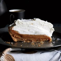 Super easy Salted caramel pie, caramel lovers' dream pie is from Simplethings Sandwich & Pie Shop in Los Angeles. The filling is sweetened condensed milk sprinkled lightly with sea salt and baked until thick and gooey, then chilled in a simple graham cracker crust.