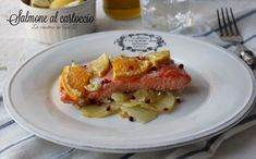 Salmone al cartoccio ricetta secondo di pesce appetitoso con anche arancia limone e falso pepe rosa Ricetta salmone al cartoccio