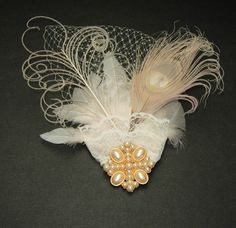 This vintage fascinator would be a lovely addition to your wedding attire...Peacock feather and all!!