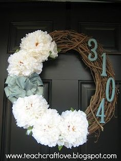 "This is a cute way to have a wreath and still show your apartment number!  Please use a metal ""over the door"" hanger or the removable sticky hangers on your door for wreaths."
