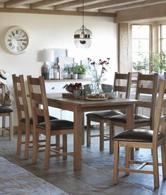 Rustic dining room with Argos Kent dining table and chairs.