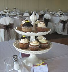 cupcake centerpiece. would love to surround the bottom of this stand with flowers and candles. simple yet pretty