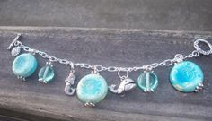beach charm bracelet -  https://www.facebook.com/pages/Silly-Little-Charms/143717322372093