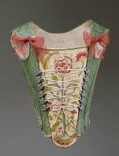 Corset, third quarter of 18th century European Green silk damask. So pretty :) http://www.metmuseum.org/toah/works-of-art/C.I.39.13.211