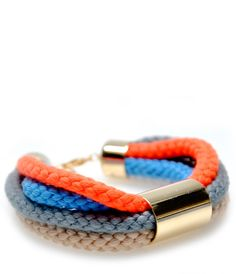 Color Cord Bracelet in Bright - A neon orange strand glows bright against nude, blue and grey hues on Sabrina Dehoff's cord bracelet.