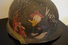 Vietnam War Helmet Graffiti | 95th Div Disney Painted Helmet Soldier Helmet, Army Helmet, Vietnam Veterans, Vietnam War, Military Art, Military History, Disney Go, Helmet Paint, North Vietnam