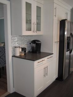 Adel Ikea cabinets with black countertop- could be used for fridge box and adjacent cabinets