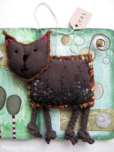 Cat | Georgina Ferrans. Soft sculpture cat. Fabric, embelishment, wire - but mostly vision.