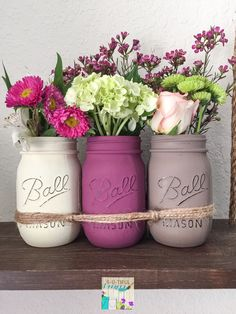 Mason Jars Centerpiece. 3 Pint Size Mason Jars. Hand Painted and distressed. Oven cured and a matte clear coat to protect the paint. Mason Jars can be painted in any color combination of your choice. Contact me if you have any questions. Visit my store for other options available. Direct link to the store: www.butifuldesigns.etsy.com  USPS Priority mail shipping with tracking number and insurance. Note: Flowers not included.