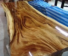 Description: All of our tables are customized and made to order. This table was a customized piece we created for a client in Asia. This very unique table was constructed from a Single Slab of Thai Acacia which is an extremely rare wood. It takes a many years for this type of wood tree to