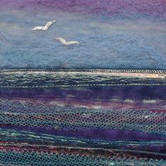 Gulls Over The Horizon  This seascape picture is a mixture of wet felt and fused fabric. The sky is made using the wet felting technique using merino and silk fibres.  The sea is a fusion of many different fabrics including organza, voile, tulle and other iridescent materials which catch the light and give the effect of reflections on water.    Picture comes complete with mount and frame. Frame measures 25 x 25 cm. Piece comes signed and well packaged. Handmade in Scotland © Aileen Clarke