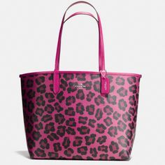 NWT Coach Reversible Tote Wild Beast! This tote is awesome! Coach ocelot wild beast print on one side and hot pink if you reverse it. Strap drop is 9 1/2 inches. Comes with wristlet inside. Brand new with tags. Coach Bags Totes