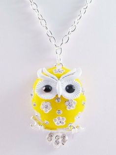 "28"" Necklace with Yellow Owl Pendant Loaded with Rhinestones Whatnotz, http://www.amazon.com/dp/B008VGN63I/ref=cm_sw_r_pi_dp_kPG7qb0S7SX1F ---- This is so cute & it is $2.49 + $4.49 for shipping."