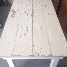 worn and weathered white farmhouse table