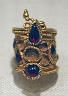 Gold ring set with garnets and amethysts  Gold ring set with garnets and amethysts Period: Hellenistic Date: 2nd century B.C. Culture: Greek